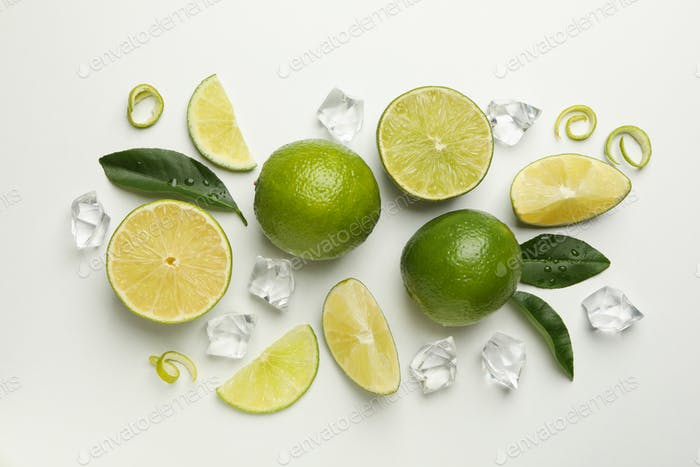 Flat lay with ripe lime on white background