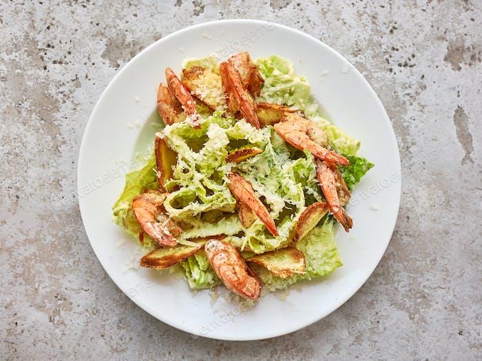 portion of cesar salad with grilled prawns