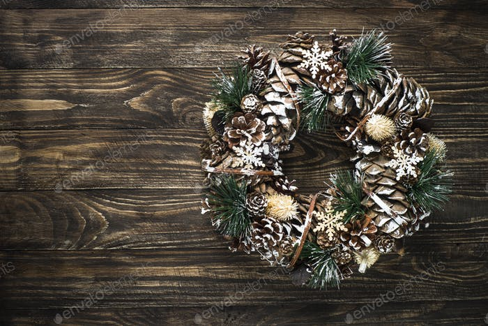Christmas wreath on dark table top view