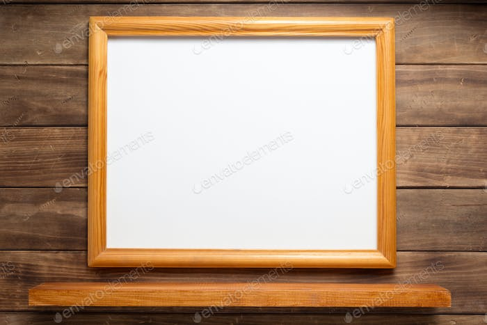 picture frame and shelf on wooden background