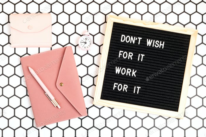 Do not wish for it, work for it. Felt letter board with the motivational quote. Top view