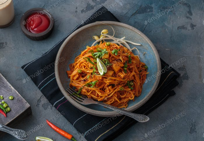 Spicy mee goreng mamak, fried malaysian or singaporean noodles with ketchup and chili