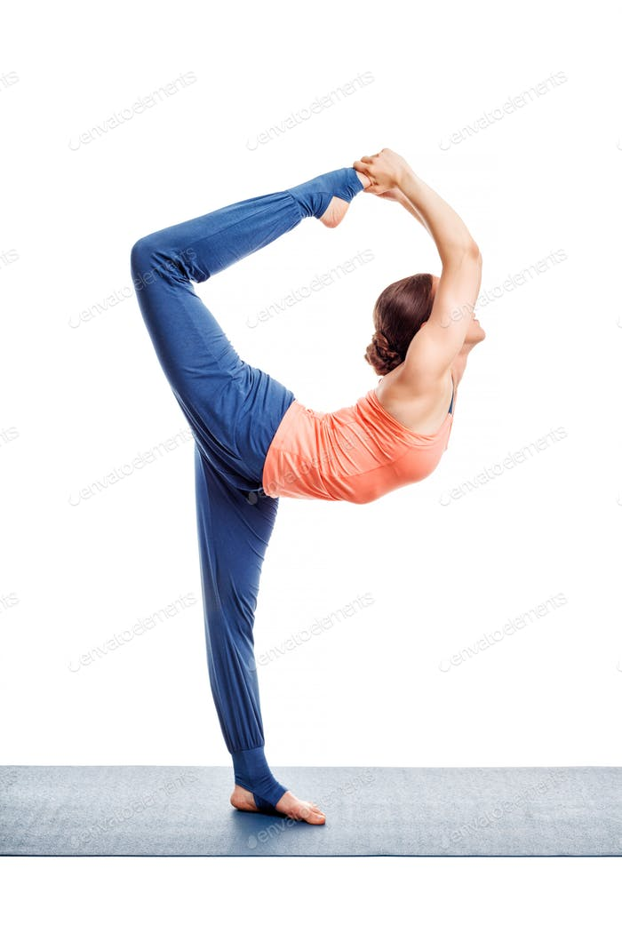 Woman doing yoga asana Natarajasana