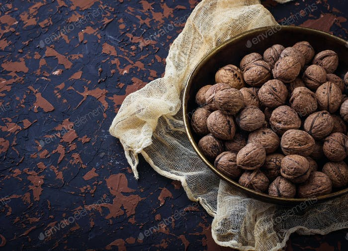 Walnuts on concrete background