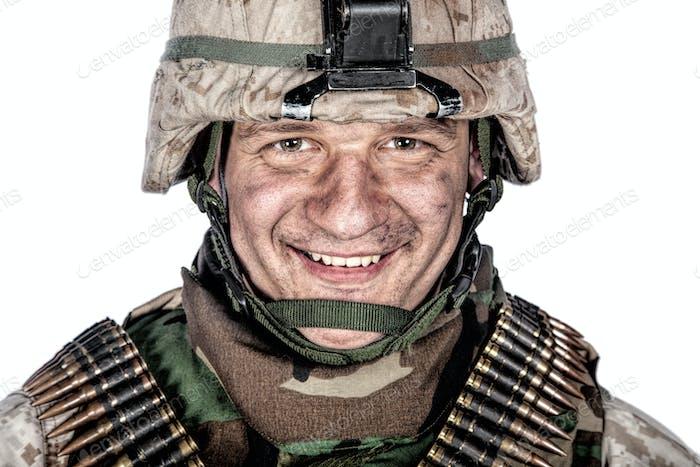 Happy smiling commando soldier in combat helmet