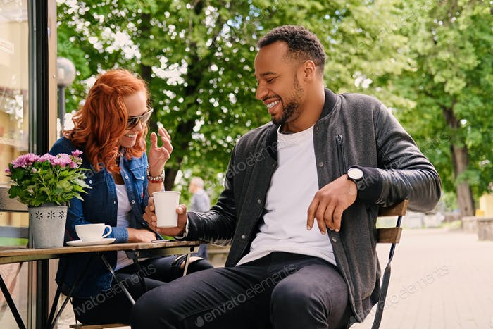 Couple drinks coffee in a cafe.