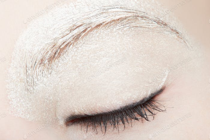 Woman eye with white make up and black eyeliner