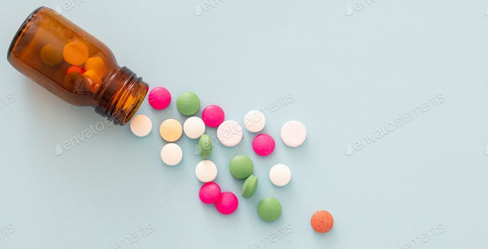 Medicine pills on blue background. Health pharmacy concept