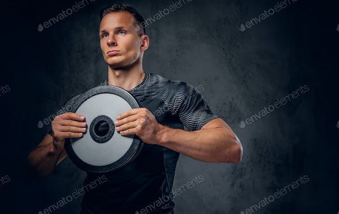 A man holds barbell weight.