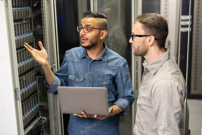 Server support specialists discussing problem of supercomputer