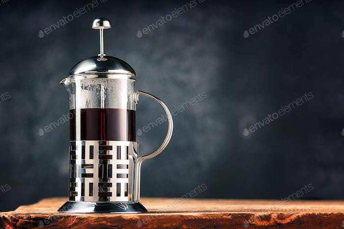 Hot tea in glass teapot