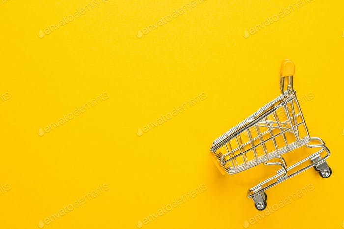 Shopping Trolley On Yellow Background