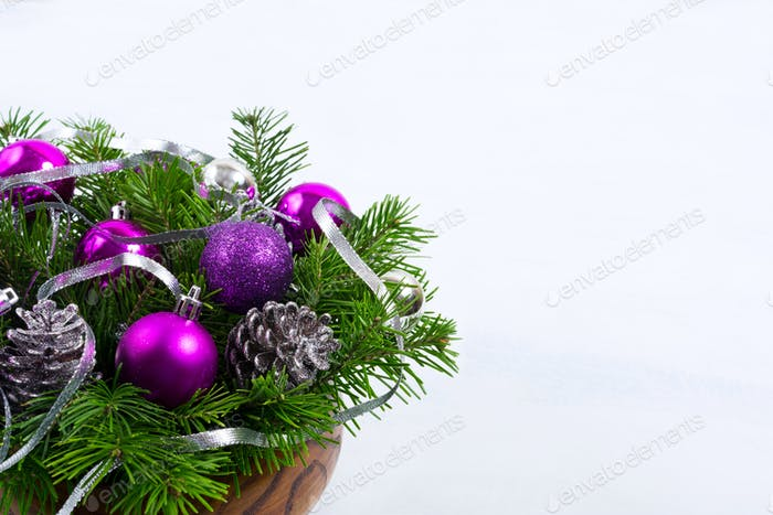 Christmas centerpiece with glitter cones and purple ornaments, c