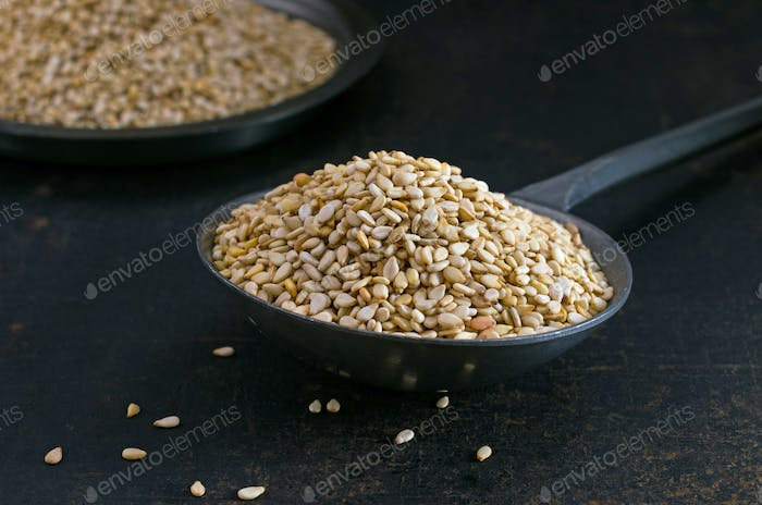Sesame seeds in a metal scoop