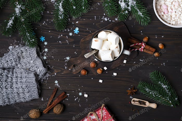 Christmas tree branches with cup of hot cocoa marshmallow