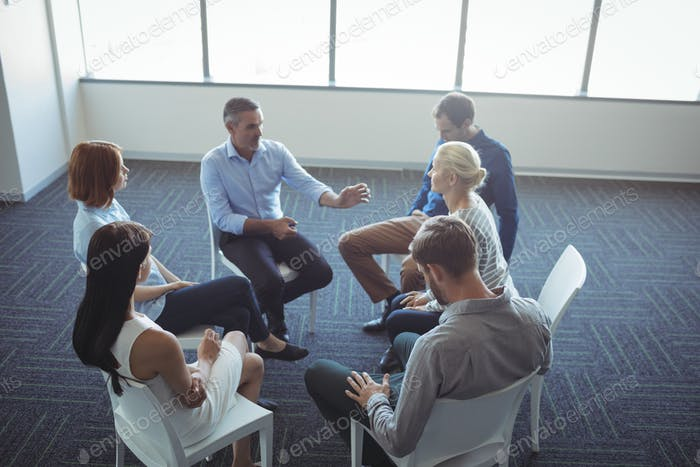 Creative business people discussing at office