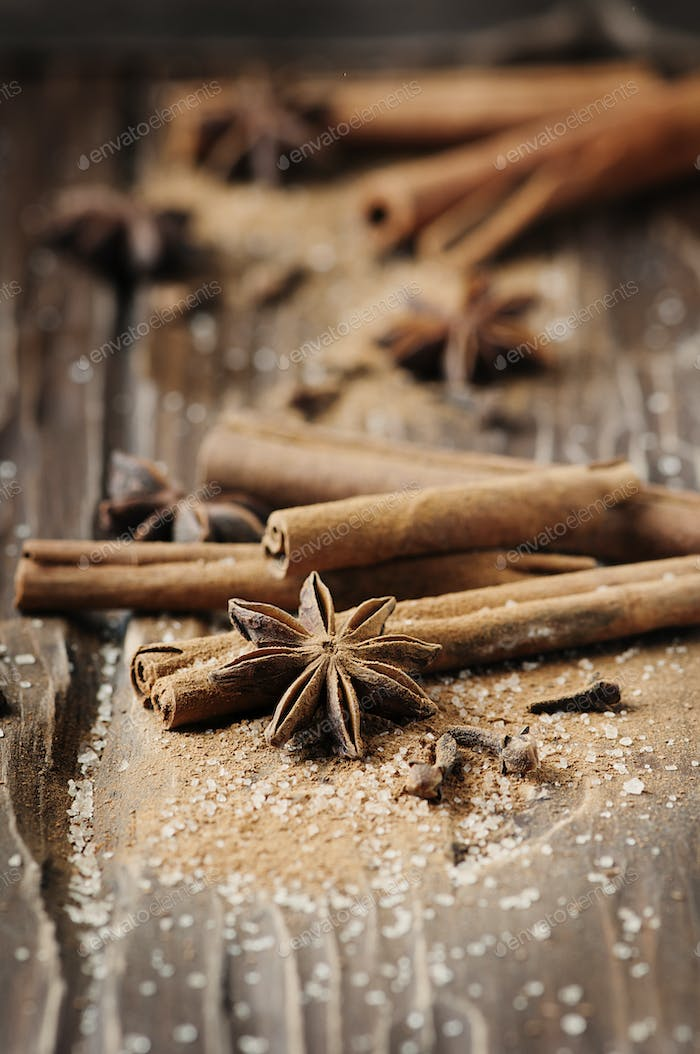 Spices cinnamon and anise on the wooden table