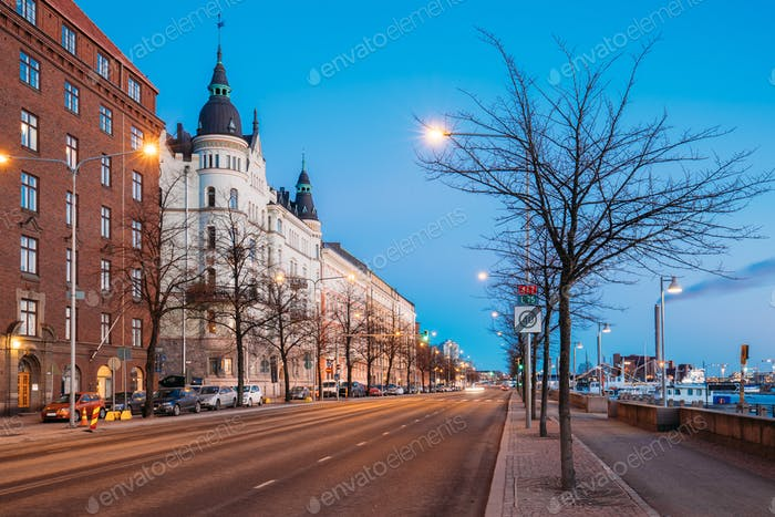 Helsinki, Finland. Night Traffic In Pohjoisranta Street In Night