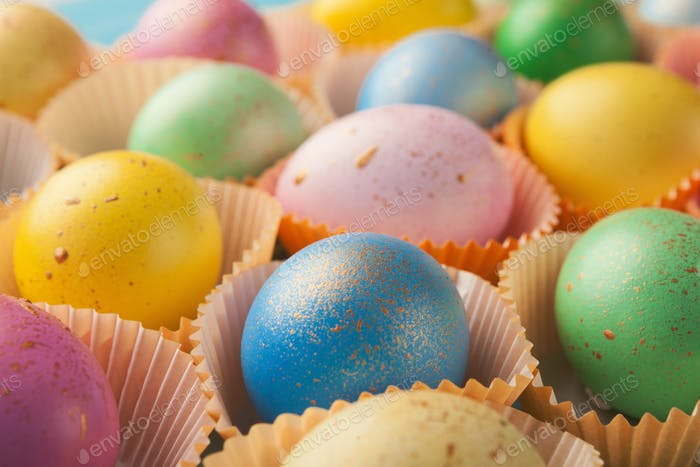 Easter background. Colored eggs closeup