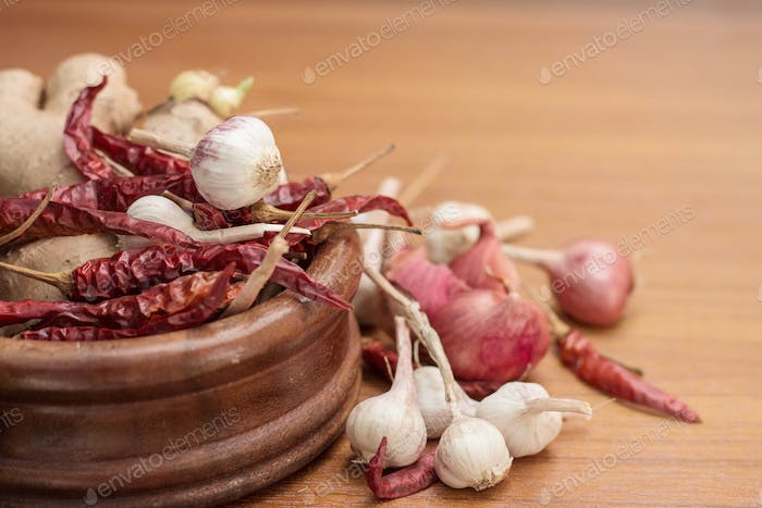 Garlic and chilli on table