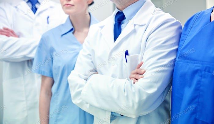 close up of medics or doctors at hospital corridor