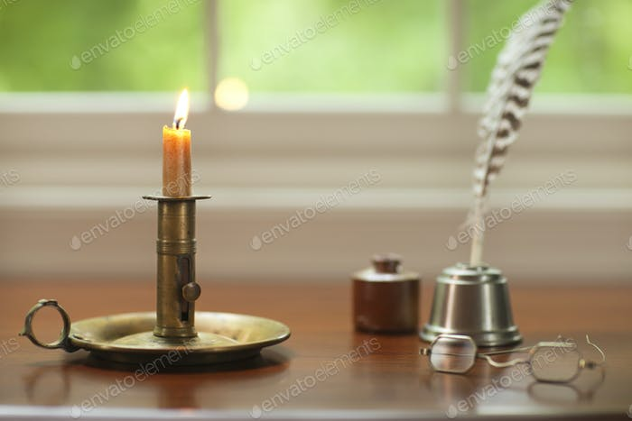Desktop and Window with Candle and Old Quill and Inkwell