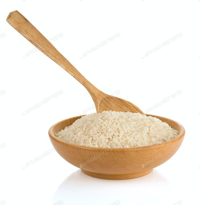Reis in Holzplatte und Löffel
