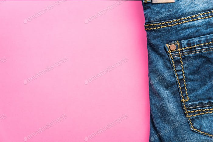 Blue jeans on pink pastel background