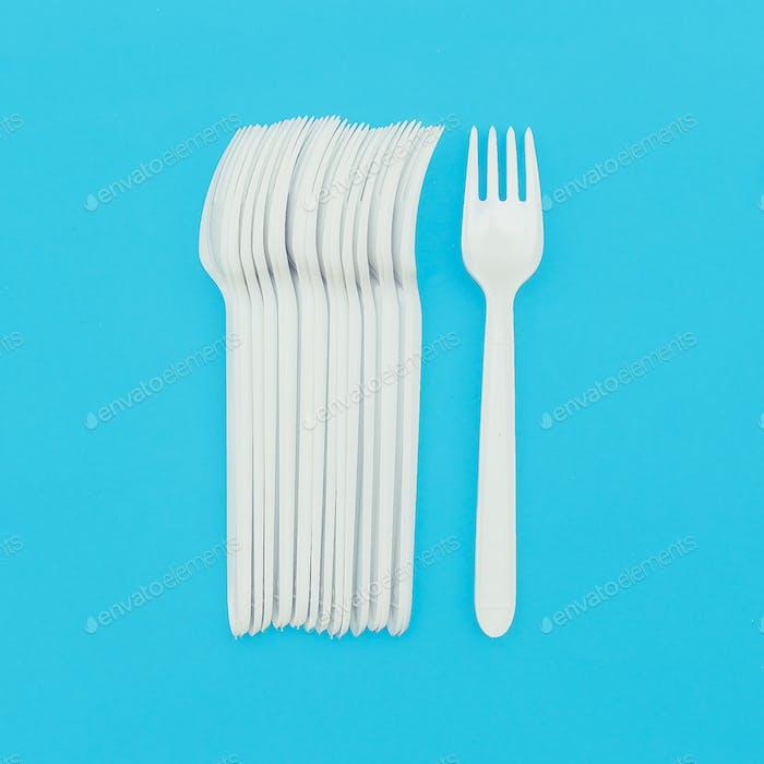 Set of plastic forks. Plastic life. Minimal art design
