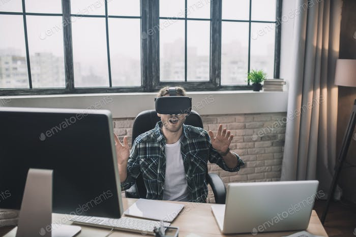 Man feeling impressed by novel VR technologies