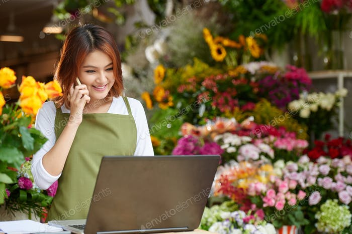 Flower Shop Owner Focused on Work