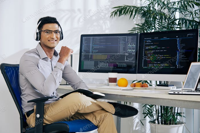 Smiling confident Indian coder