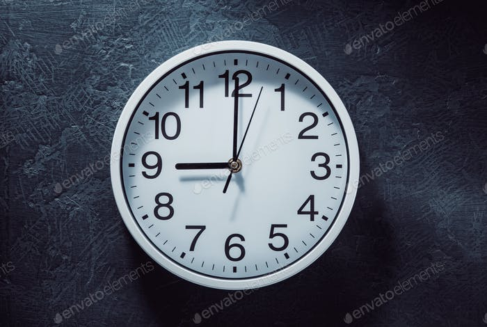 wall clock at old black background