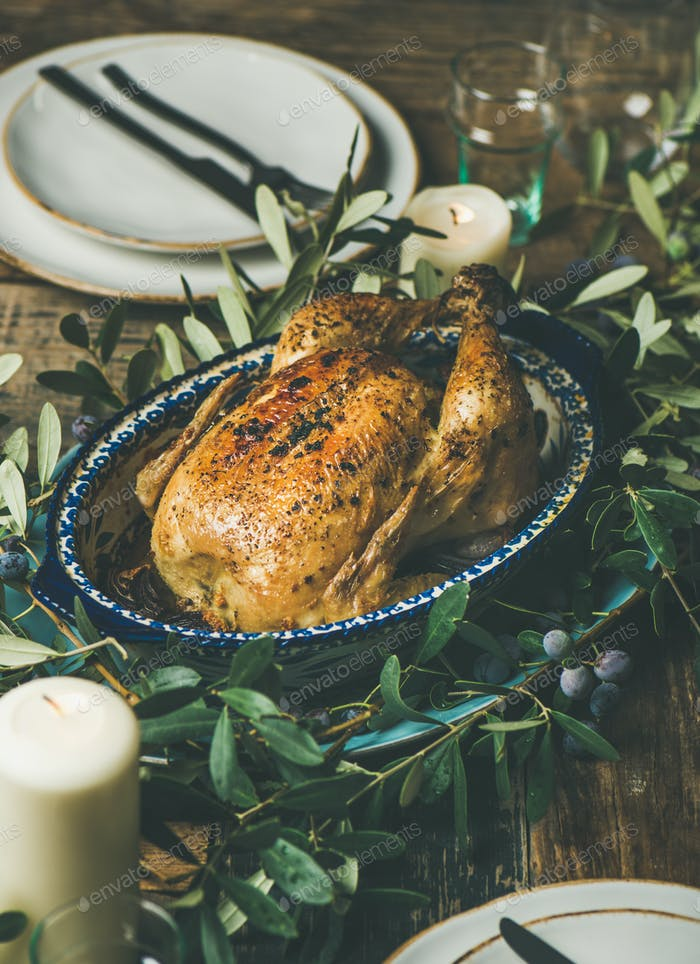 Whole roasted chicken decorated with olive tree branch