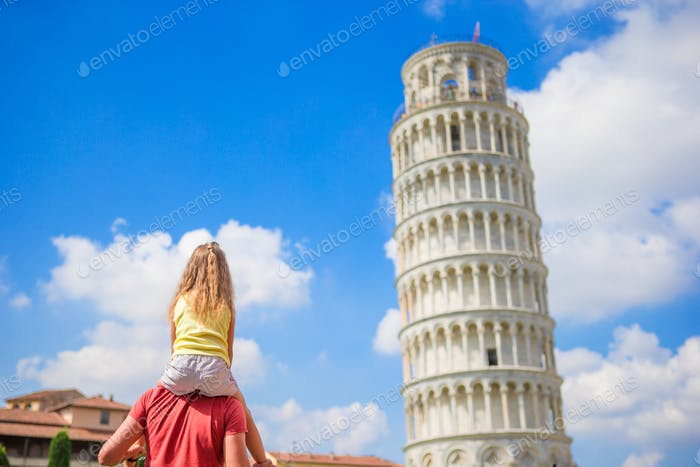 Family of dad and kid background the Learning Tower in Pisa. Pisa - travel to famous places in
