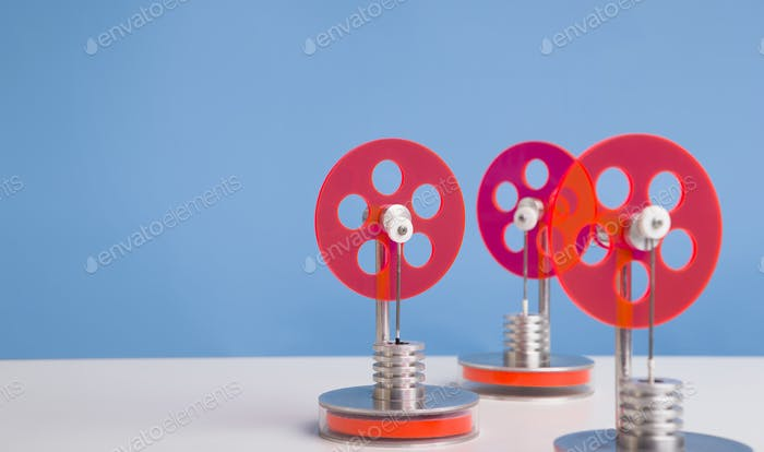 Set of red plastic gears for energy producing
