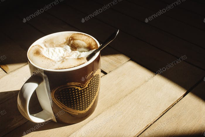 delicious aromatic  brewed whipped with icecream coffee in a brown cup