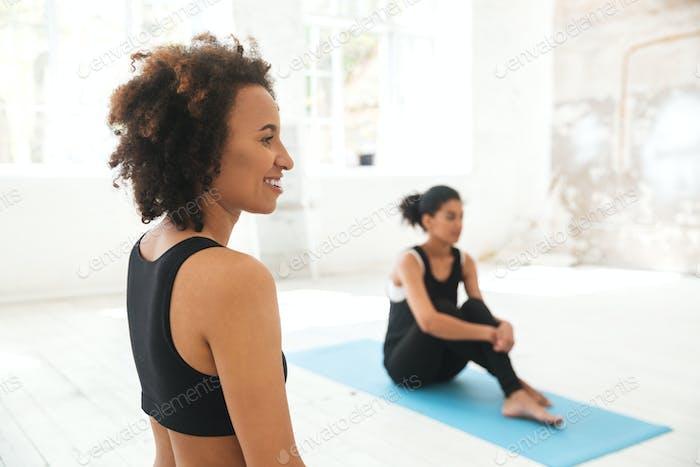 Multiethnic people in yoga studio