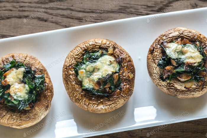 Baked mushrooms stuffed with spinach and cheese