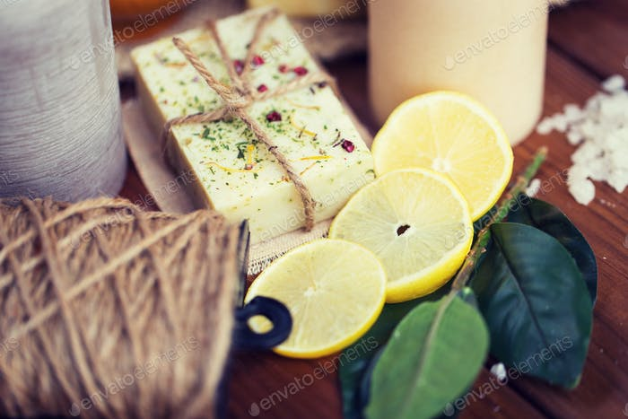 close up of natural soap and candles on wood