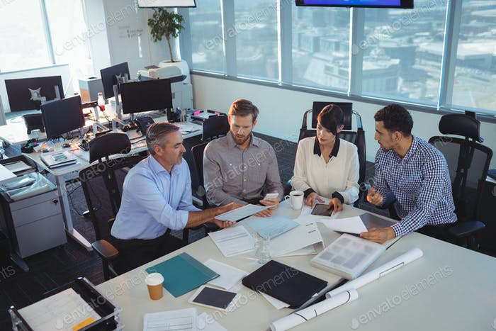 Business people discussing in meeting at office desk