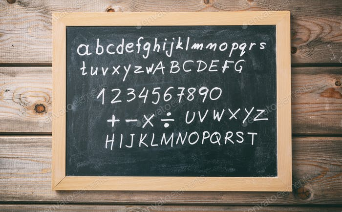 Letters and numbers on a blackboard with frame on wooden wall background