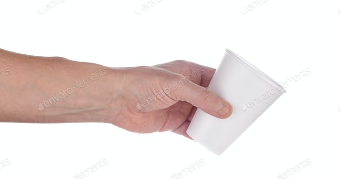 Hand holds out white plastic cup