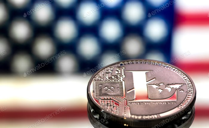 coin of litecoin on an American flag background, the concept of virtual money, closeup