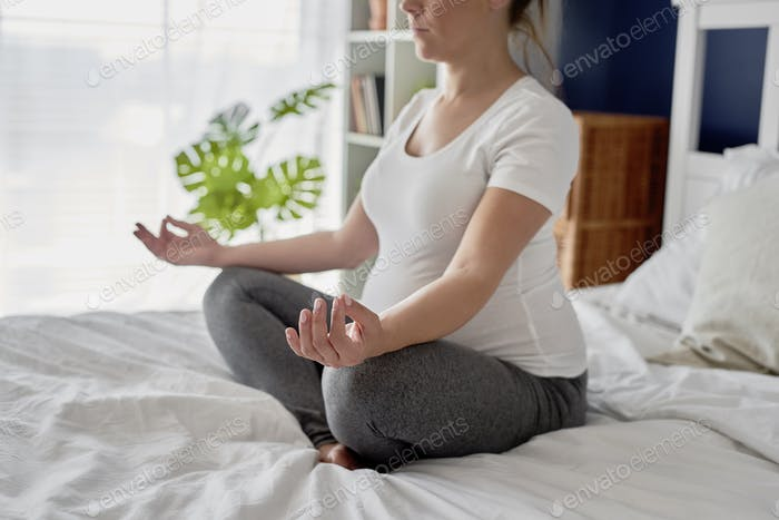 Woman in advanced pregnancy practicing meditation