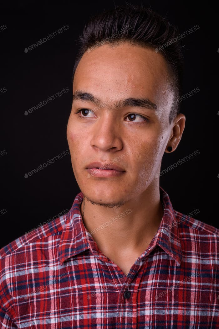 Face of young handsome Indian hipster man