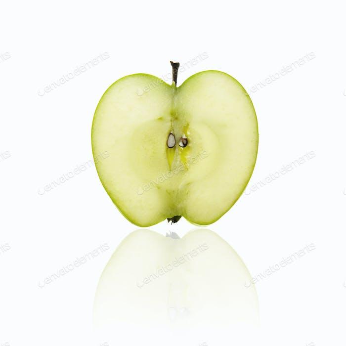 Cross section of an apple, cut in half.