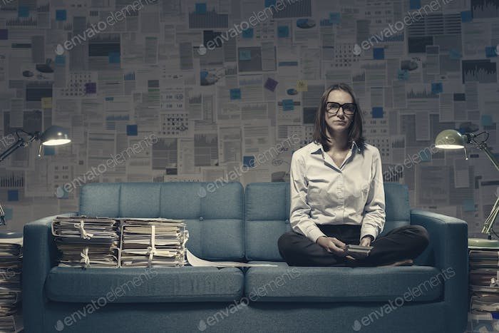 Businesswoman working on the sofa late at night