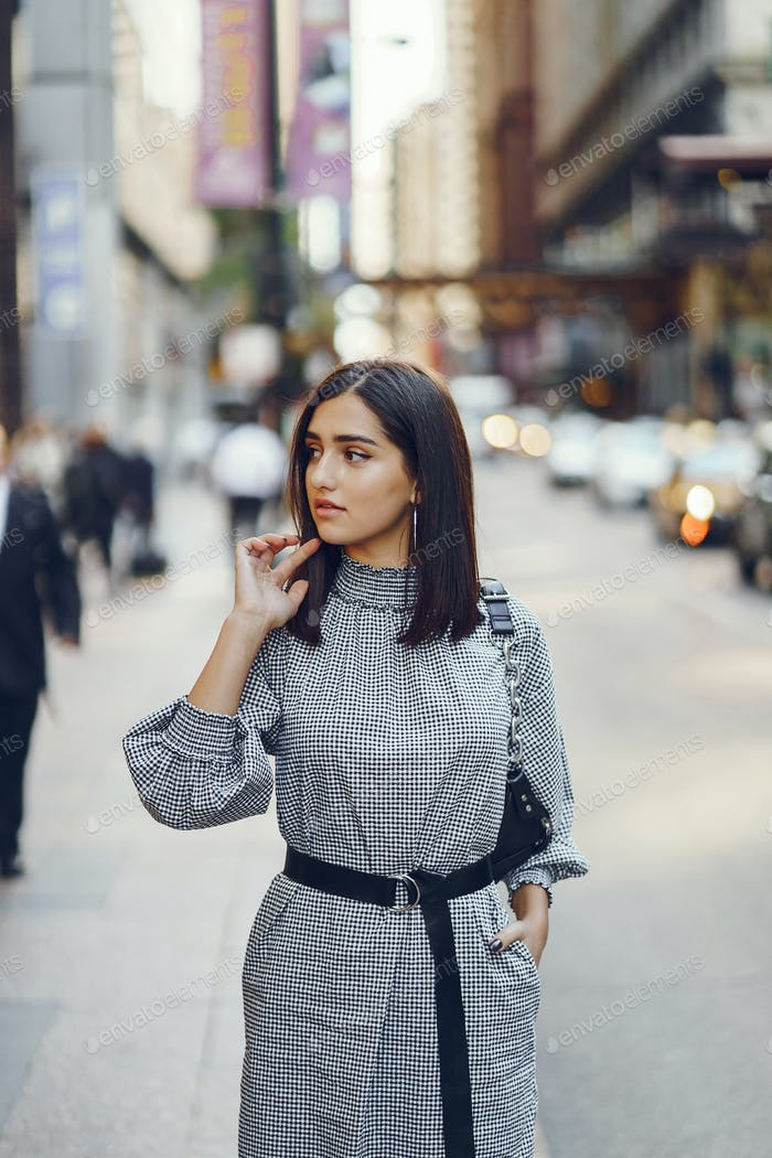 beautiful brunette girl exploring the city during autumn