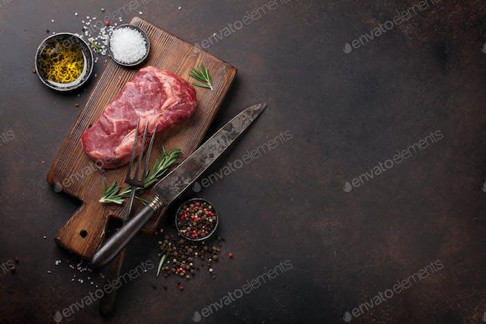 Raw ribeye beef steak cooking